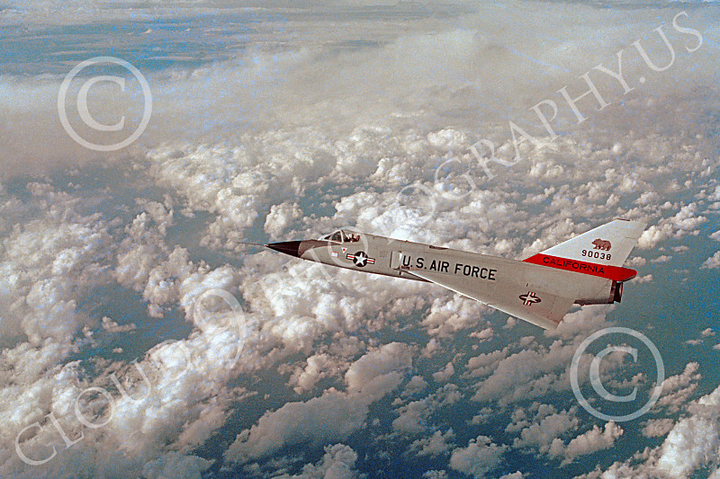 F-106ANG 00014 A Convair F-106 Delta Dart fighter interceptor California ANG in flight over clouds and the Pacific Ocean by John Peterson