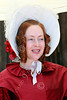 HR-FtRossRUSS 00049 A standing smiling red hair civilian female with a haat Ft Ross California Russian settlor historical re-enactor picture by Peter J Mancus