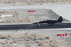 F-5USN 00195 A black Northrop F-5B Freedom Fighter jet fighter USN 761580 VFC-13 SAINTS rolls out after landing at NAS Fallon 1-2015 military airplane picture by Peter J Mancus