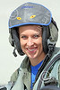 ACM 00411 A nice portrait of a smiling, helmeted, female, USN F-16 fighter pilot--one of only three in the USN, at NAS Fallon, by Peter J Mancus