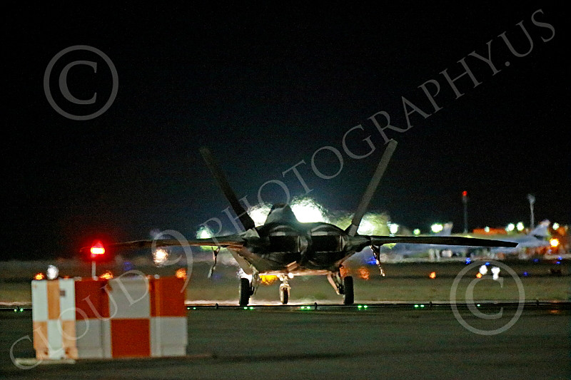 F-22USAF 00535 A Lockheed F-22 Raptor USAF stealth jet fighter taxis for a night Red Flag mission at Nellis AFB 7-2014 military airplane picture by Peter J Mancus