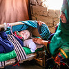 Young Mother with Baby in IDP Camp, Afghanistan
