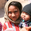 Young Girl with Baby Brother at IDP Camp in Afghanistan