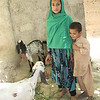 Shakila, 9 years old playing with neighbour boy