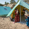 Nergz (left), Dawood (6months), Sleman and Hariman (6) fled Shingal 12. August. Since then they have lived in an overcrowded unfinished building structure together with 85 people. 27. August they could move into a tent given by UK aid through the Norwegian Refugee Council. <br /> <br />  Tents from UK aid are being pitched for displaced Iraqi families who have taken shelter under trees and in unfinished buildings in Zawita and Zahko in Dohuk, Northern Iraq. In total NRC is pitching 430 tents and is distributing kitchen sets from UK aid - for displaced Iraqi families. Photo: Tiril Skarstein, Norwegian Refugee Council<br /> 