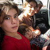 Jalal and his family fled Sinjar 3rd August. After six days in Sinjar mountains they were able to cross into Syria and 21st August they entered the Kurdish region in Northern Iraq, where they hope to be able to find shelter with some relatives. The photo shows his children and nieses in the back of the car crossing the border back into Iraq. Photo: Tiril Skarstein, NRC