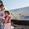 Sidra – 3 years old (girl)<br /> Riham – 10 years old (girl)<br /> in a camp in Dokuk, Iraq.<br /> <br /> They left Mosul over 10 days ago. 'We were really scared and we have had no news since we left. We don't know what has happened to our house and we didn't have time to bring much with us. My priority was to get the children to safety. It has not been easy for little Ayham. She is getting sick from the extreme heat here'.  'When we first fled, we stayed with people we knew. But we didn't want to become a burden and we couldn't stay with them forever, so we left and came to this camp.' 'Riham is a really good student and she is in the 5th grade and loves school (Riham nodded when her mother said this). But now we don't know what will happen to her education. I really hope there will be a school here for us so that she can continue with her studies', says their mother Umm Riham. Photo: Tiril Skarstein, NRC