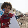 Sidra – 3 years old (girl) in a camp in Dokuk, Iraq.<br /> <br /> They left Mosul over 10 days ago. 'We were really scared and we have had no news since we left. We don't know what has happened to our house and we didn't have time to bring much with us. My priority was to get the children to safety. It has not been easy for little Ayham. She is getting sick from the extreme heat here'.  'When we first fled, we stayed with people we knew. But we didn't want to become a burden and we couldn't stay with them forever, so we left and came to this camp.' 'Riham is a really good student and she is in the 5th grade and loves school (Riham nodded when her mother said this). But now we don't know what will happen to her education. I really hope there will be a school here for us so that she can continue with her studies', says her mother Umm Riham. Photo: Tiril Skarstein, NRC