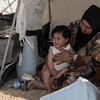 Umm Riham (mother) and Ayham (1 year old girl) in a camp in Dokuk, Iraq.<br /> <br /> They left Mosul when the city was taken over by armed groups. 'We were really scared and we have had no news since we left. We don't know what has happened to our house and we didn't have time to bring much with us. My priority was to get the children to safety. It has not been easy for little Ayham. She is getting sick from the extreme heat here'.  'When we first fled, we stayed with people we knew. But we didn't want to become a burden and we couldn't stay with them forever, so we left and came to this camp.' 'Riham is a really good student and she is in the 5th grade and loves school (Riham nodded when her mother said this). But now we don't know what will happen to her education. I really hope there will be a school here for us so that she can continue with her studies'. Photo: Tiril Skarstein, NRC