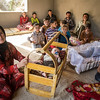 Nergz (left), Dawood (6months) and their family fled Shingal 12. August. Since then they have lived in an overcrowded unfinished building structure together with 85 people. 27 August they could move into a tent given by UK aid through the Norwegian Refugee Council. <br /> <br /> Tents from UK aid are being pitched for displaced Iraqi families who have taken shelter under trees and in unfinished buildings in Zawita and Zahko in Dohuk, Northern Iraq. In total NRC is pitching 430 tents and is distributing kitchen sets from UK aid - for displaced Iraqi families. Photo: Tiril Skarstein, Norwegian Refugee Council<br /> 