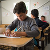 "Mohammed (11) – student at an NRC supported school in Azraq refugee camp in Jordan. Photo: Tiril Skarstein, NRC<br /> <br /> Interview, Azraq, 17.09:<br /> ""I arrived about 3 months ago (June). Since I arrive, before Ramadan, I've been going to this school. I went to third grade in Syria and was supposed to continue to 4th grade – but now I have to take third grade again. <br /> (Because the education was disrupted by the war)<br /> I go to school because I want to learn. I want to know how to read and write, because I want to be a doctor when I grow up, so that I can treat people. There is a need for doctors. Many people need medical help, because of the bombings inside Syria. <br /> I got hit in my head as a result of one of the bombings, but I'm fine now. <br /> I like Maths. Maths and Arabic are my best subjects. <br /> What do you do after school?<br /> If I have something to study, I study. Or I play football with my friends. <br /> When the bombings were bad, the school ended. Then we fled.<br /> We had sheep in Syria, and I liked to shepherd them. My sheep are still in Syria.  <br /> When the situation is better, I would really like to go back, because I love Syria. It is better than being a refugee. I would rather like to go back to my own country, but right now I cannot, because of the bombings and the war.<br /> Azraq is not too bad. I'm learning and I'm not wasting my time. My cousins are here as well. """