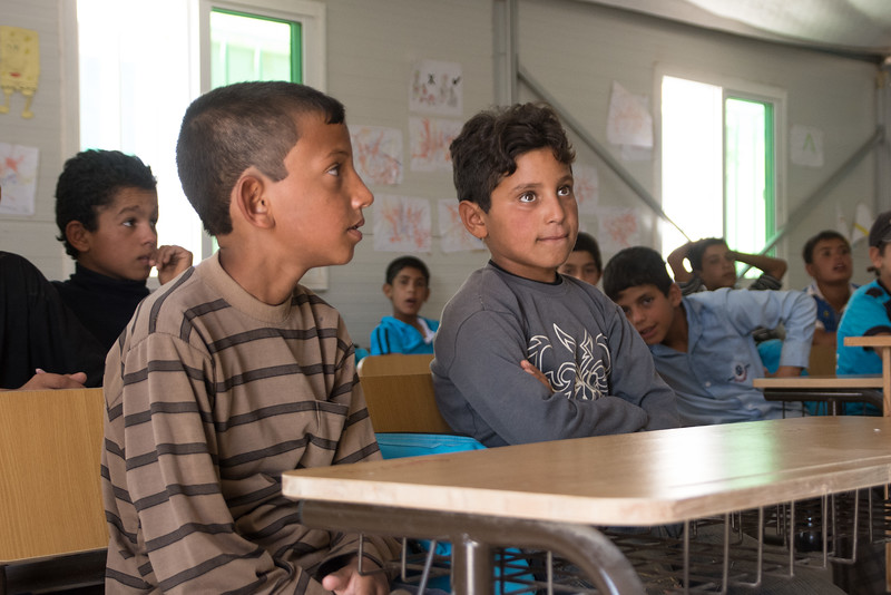 """Mohammed (11) to the right and Ali (11) to the left – students at a NRC eduaction program in Azraq refugee camp in Jordan. Photo: Tiril Skarstein, NRC<br /> <br /> Interview with Mohammed, Azraq, 17.09:<br /> <br /> """"I like to learn. I want to become a doctor when I grow up, so that I can treat people. There is a need for doctors. Many people need medical help, because of the bombings inside Syria"""", says Mohammed (11), who is currently enrolled in a NRC education program in Azraq refugee camp in Jordan. <br /> <br /> During spring 2014 he fled from a village in Syria, together with his family, as the security situation in the area deteriorated. <br /> <br /> """"When the situation is better, I would really like to go back, because I love Syria. It is better than being a refugee. But right now I cannot, because of the bombings and the war"""", he explains. <br /> <br /> <br /> Mohammed has been able to continue his education after fleeing Syria. He is one of the lucky ones. Half of the refugee children are out of school, many due to lack of funding for education activities."""
