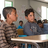 """Mohammed (11) to the right and Ali (11) to the left – students at a NRC eduaction program in Azraq refugee camp in Jordan. Photo: Tiril Skarstein, NRC<br /> <br /> Interview with Mohammed, Azraq, 17.09:<br /> """"I arrived about 3 months ago (June). Since I arrive, before Ramadan, I've been going to this school. I went to third grade in Syria and was supposed to continue to 4th grade – but now I have to take third grade again. <br /> (Because the education was disrupted by the war)<br /> I go to school because I want to learn. I want to be a doctor when I grow up, so that I can treat people. There is a need for doctors. Many people need medical help, because of the bombings inside Syria. <br /> <br /> I got hit in my head as a result of one of the bombings, but I'm fine now. <br /> <br /> I like Maths. Maths and Arabic are my best subjects. <br /> <br /> What do you do after school?<br /> <br /> If I have something to study, I study. Or I play football with my friends. <br /> <br /> When the bombings were bad, the school ended. Then we fled.<br /> <br /> We had sheep in Syria, and I liked to shepherd them. My sheep are still in Syria.  <br /> <br /> When the situation is better, I would really like to go back, because I love Syria. It is better than being a refugee. But right now I cannot, because of the bombings and the war.<br /> <br /> Azraq is not too bad. I'm learning and I'm not wasting my time. My cousins are here as well. """""""