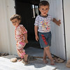 Ahmed (4) and his little sister Noor (1,5) have recently arrived to Azraq refugee camp in Jordan from Syria. Photo: Tiril Skarstein, NRC<br /> <br /> Interview, 17.09, with mother Hanna:<br /> We fled because our house got destroyed in the bombings. I wish we can go back to rebuild it and be able to proide a better furture for the children. But right now we feel comfertable and safe here in Jordan.
