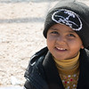 Mohammed (5) recieves winter clothes and blankets from NRC in Azraq, Jordan. Photo: Tiril Skarstein