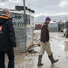 """Jan Egeland following Anwar (29), a Syrian refugee from Idlib, trough the informal tented settlement Arab Rajab in Al Marj in Bekaa, where Anwar lives. <br /> <br /> """"I want my children to have a better future. For us it's over,"""" Anwar said.<br /> <br /> Egeland visited Syrian refugees in the Bekaa Valley in Lebanon on February 25, 2015.  <br /> <br /> Photo: NRC/Tiril Skarstein"""
