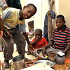 """Children having a meal in """"Bosnia"""" camp for displaced people in Mogadishu. Photo credit: NRC/Christian Jepsen January 2012"""