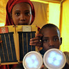 With solar panels, batteries and lamps, supplied by NRC, these internally displaced children in Mogadishu can study when the sun sets. Photo credit: NRC/Christian Jepsen January 2012