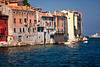 Old buildings in Rovinj being lapped at by the Adriatic
