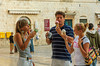 A group of young people eating ice cream in the old town of Dubrovnik, Croatia.