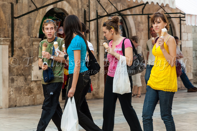 A group of young people eating ice cream in old town, Dubrovnik, Croatia.