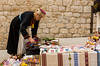 A female street vendor selling ethnic craft items in old town Dubrovnik, Croatia.