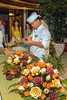 A chef demonstrating the art of fruit and vegetable carving to make flower arrangements on the Holland America cruise ship Zaandam