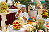 A chef preparing the  buffet food extravaganza on the deck of the Holland America cruise ship Zuiderdam.