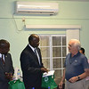 Governor Holiday of St. Maarten and Governor Berkel of St. Eustatius receive new DCNA bird guides as a thank you for their support. Photo Credit: Nathaniel Miller, DCNA