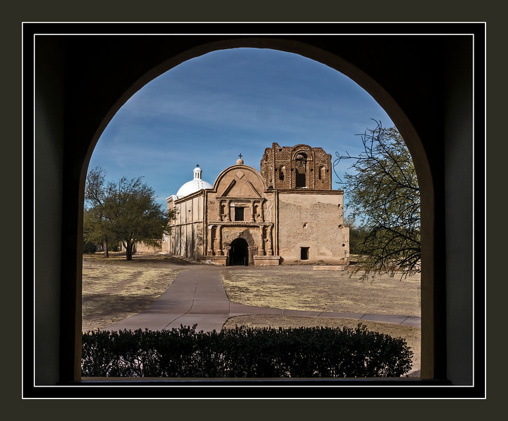 "Looking back, down the long tunnel of time.<br /> Mission San José de Tumacácori, Arizona<br /> <br /> DP100-2013  Posted April 10, 2013; processed ditto<br /> <br /> Taken December 22, 2012<br /> This historic Spanish mission was established in 1691 by Father Kino at the supposed invitation from the local tribe of Tohono O'odham people.  The existing Franciscan church dates to the late 18th century.  It lies 50 miles south of Tucson, just off I19.  Read more about it at its National Park Service website, <a href=""http://www.nps.gov/tuma/index.htm"">http://www.nps.gov/tuma/index.htm</a>, or on Wikipedia, <a href=""http://en.wikipedia.org/wiki/Tumac%C3%A1cori_National_Historical_Park"">http://en.wikipedia.org/wiki/Tumac%C3%A1cori_National_Historical_Park</a>"