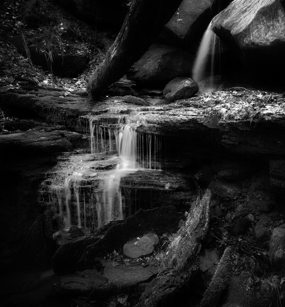 April 27 - Water on the Rocks<br /> <br /> I had to walk/hike up a small ravine to capture this image.  The sound of the flowing water was so peaceful and I like the contrast of the soft water flow against the hard edges of the rock.