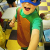 BRYAN EATON/ Staff Photo. Brendan Coffey, 6, strikes a pose in his Ninja Turtle outfit on Wednesday. The Boys and Girls Club had a Halloween in July themed day where they got treats from the counselors and then paraded around the building.
