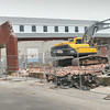 BRYAN EATON/ Staff Photo. A large excavator takes down the old Amesbury DPW garage on Water Street yesterday. Their new location is on South Hunt Road.