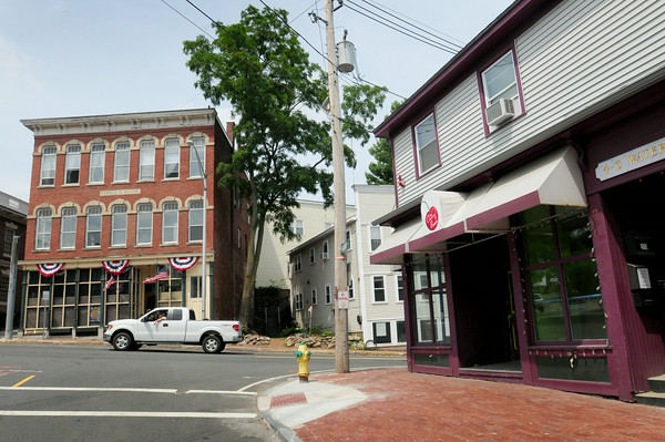 BRYAN EATON/ Staff Photo. Changes in the making for the Rowell's Block, left, and the space that housed Cherry Bomb, right, in downtown Amesbury.