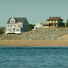 BRYAN EATON/ Staff Photo. Those on the tour could see the effects of erosion on Plum Island and the rocks put in place for proctection including Bennett Hill Cottage at right.