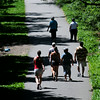 JIM VAIKNORAS/Staff photo Walkers move in and out of shadows as the make their way down the Rail Trail in Newburyport Saturday morning.