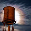 November 22, 2007<br /> <br /> IMG_6876c Moon Lit Water Tower-<br /> <br /> Same tower as a few days ago, only at night-  The back lit sky and blurred clouds make it a little more interesting, I think-