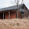 "February 4, 2010 - ""Log Barn""<br /> <br /> The former Dunn/Tirk log barn is at McPherson Park in Colleyville, TX. Orginally built in the late 1800's the barn is one of the few existing log structures remaining in the county. Pioneer William Dunn who farmed the land from 1875-90 built the the double-crib barn with the dog run plan.  Hay was unloaded directly from the wagons into the cribs."