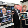 9-9-14 BALTIMORE, MD- From left , Chad McCauley, Director- Product Management; Thomas Coughlin, regional senior vice president; Patricia Furman, manager- product management. Show here displaying Concast's X1 DVR with cloud technology and live in home streaming which allows customers to turn any mobile device into a personal television. (The Daily Record/Maximilian Franz).