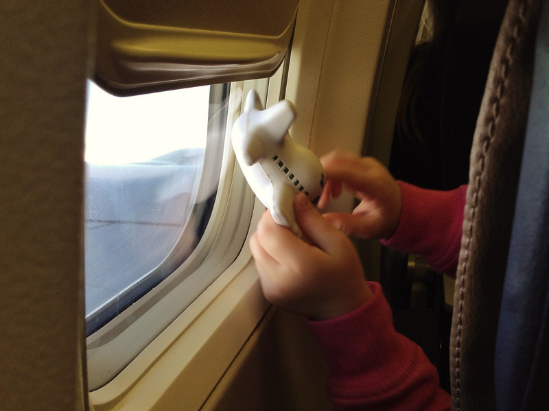 Plane Play 2013-12-20 Little girl in front of me on the plane had a plane toy. Aww.