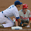 Dodgers' James Loney looks to tag out Phillies' Chase Utley at first base on a pitch-back in the second inning of the game played at Dodger Stadium in Los Angeles, CA, on Monday, July 16, 2007 where the Dodgers lead 3-1.<br /> (John Lazar/L.A. Daily News Staff Photographer)