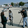 Van Nuys Airport Director of Public and Community Relations Diana Sanchez, left, spends time with her job shadow studentÑ San Fernando High senior Adriana Garcia on the tarmac as Will Pupa of MJE Marketing films them during the Flight Path to the Future job shadow program held at Van Nuys Airport on Friday, February 29, 2008. (John Lazar/L.A. Daily News Staff Photographer)