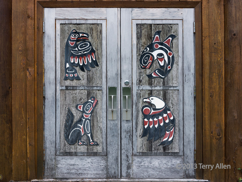 Door to the Klemtu Big House   The door contains totemic figures for the four clans that live in Klemtu, including, going clockwise from upper left: raven, killer whale, eagle and wolf.  Photos showing the details of the marvelous totem poles inside the big house can be seen here: http://goo.gl/WvCSUL  3/10/13 www.allenfotowild.com