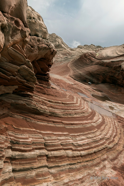 """Curving striations of white and red sandstone, White Pockets, Vermillion Cliffs National Monuments, Arizona<br /> <br /> Everywhere you look in White Pockets there is amazing art work by Mother Nature. Since the site is remote, it is rarely visited, which keeps it in pristine condition.<br /> <br /> Other new photos from White Pocket can be seen here: <a href=""""http://goo.gl/S14eP5"""">http://goo.gl/S14eP5</a><br /> <br /> 20/08/14  <a href=""""http://www.allenfotowild.com"""">http://www.allenfotowild.com</a>"""