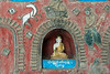 """Close-up of a small Buddha<br /> <br /> Next to the Shwe Yaunghwe Kyaung Monastery at Nyaungshwe, near Lake Inle, there is a stupa that contains hundreds of wall niches, each occupied by a small statue of a Buddha, each only 3 or 4 inches high.  The niches are surrounded by leaded glass insets and figures attached to the walls. I especially like the dynamic figure of the dog, which is a little unusual in Buddhist art. I like to think that one of the monks who was involved in the decoration of the stupa decided to sneak in an image of his favorite pet! Early graffiti? Some of the Buddha figures are dressed in red robes (see link, below)<br /> <br /> Other views of the interior of the stupa, and of the nearby monastery can be seen here: <a href=""""http://goo.gl/TY8C02"""">http://goo.gl/TY8C02</a><br /> <br /> 06/03/14 www.allenfotowildcom"""