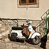 With its narrow cobblestone street and steep inclines, mopeds are a popular way to get around in Taormina, Sicily