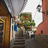 Cobblestone streets, grapevine draped buildings, and intriguing shops abound in Positano, on the Amalfi Coast in Italy