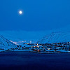 Moon rises over Kjollefjord Norway where fishermen pull 40 tons of King Crab from the fjord every day