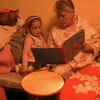 Video Archive Clip 2008 (Dec 25) - Yaden, Julie - Age 54 - Christmas Day - Grandma reads to granddaughter Jaycene (age 3) and grandson Jacob (age 19 mos) - Fire Rock Place home - Loveland, CO - Video taken by Matt Yaden (2 min 57 sec)