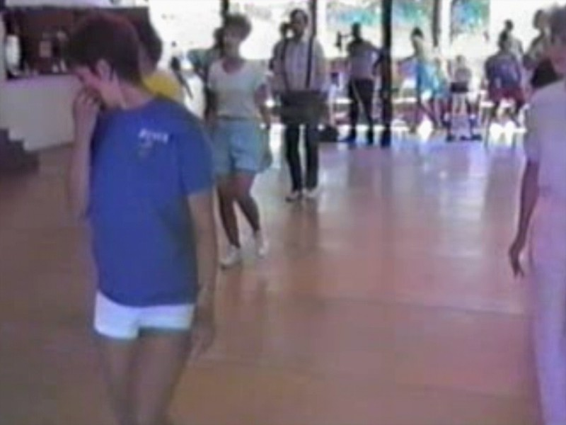 "Video Archive Clip 1987 (Aug) - Yaden Clogging - Julie (age 33) follows the Seattle girls in dancing the ""Break My Stride"" routine - Circle 8 Ranch Clogging Workshop - Cle Elum, WA (2 min 10 sec)<br /> <br /> Dan's note:<br /> <br /> The Circle 8 Ranch workshops were the first we attended after learning to clog.  The workshops were great fun and motivated us to attend future clogging workshops throughout the country over the next few decades.<br /> <br /> One bone to pick, however, with this clip.  Notice how Julie never looks over to me at the right of the screen to duplicate the fancy footwork on display.....oh well.....her loss...."